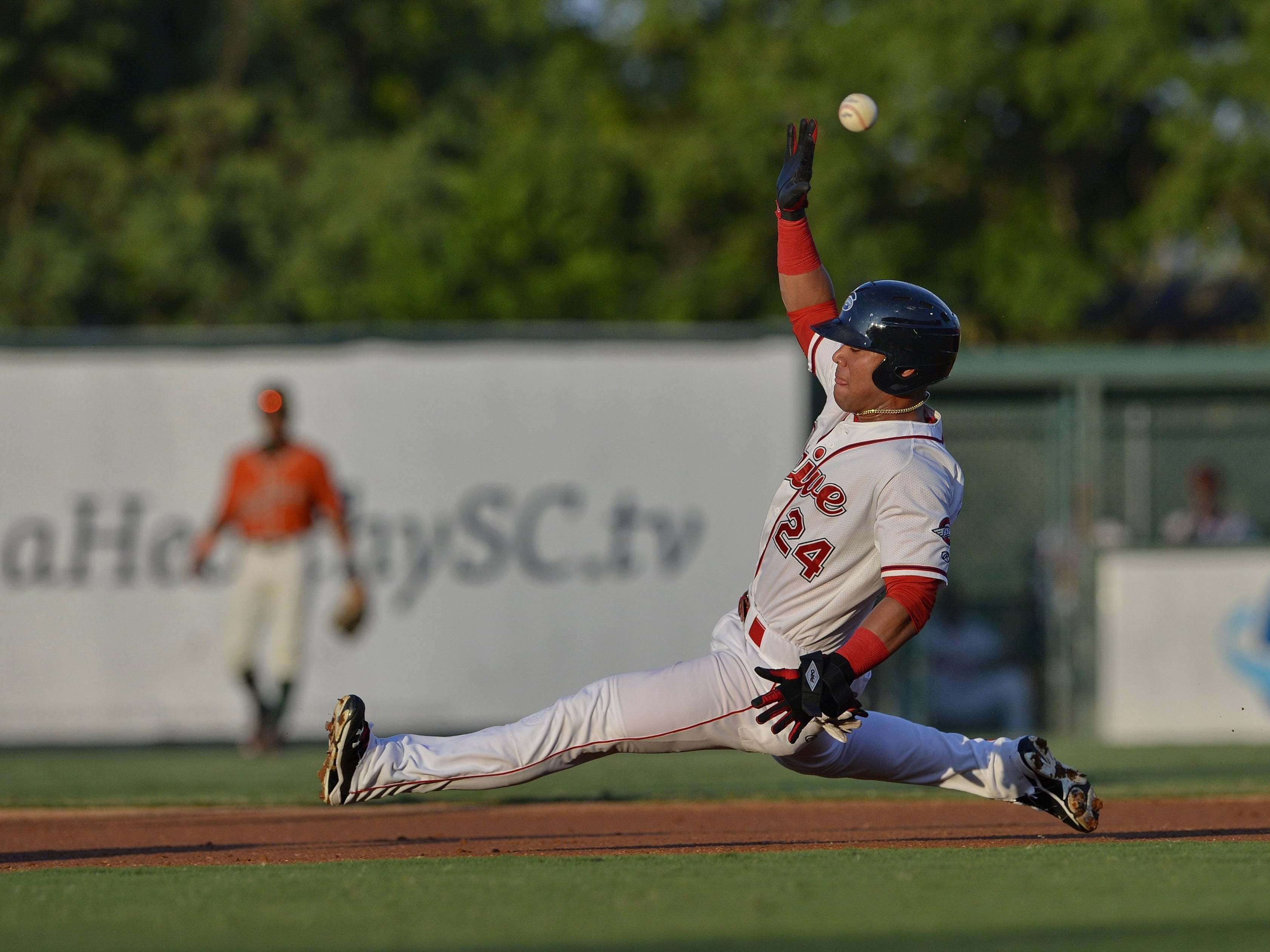 Greenville's Yoan Moncada slides into second base for his 41st stolen base during the Drive's game Tuesday against the Greensboro Grasshoppers at Fluor Field.