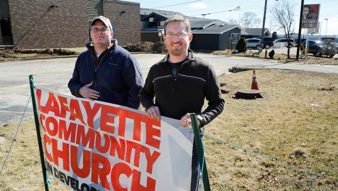 Associate pastor Billy Hardy, left, and pastor Jeff Mikels Wednesday, March 2, 2016, at Lafayette Community Church, 2301 Concord Road in Lafayette. The church will be next door neighbors with Filly's Gentlemens Club, background.