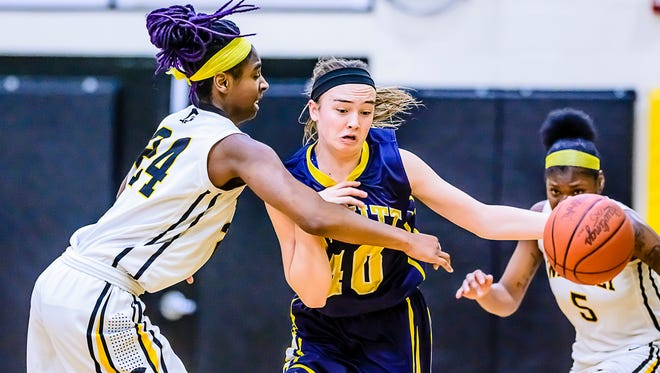 Ciara Willheart, left, of Waverly commits a reach-in foul on Madison Petersen of DeWitt Friday.
