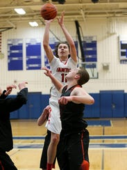 Two Northville defenders shadowed Canton senior forward