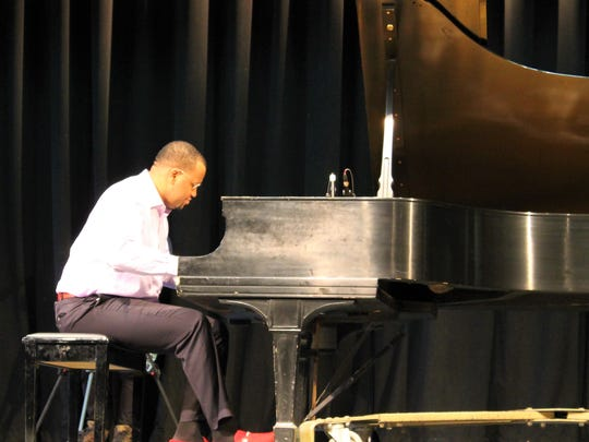 Jazz pianist and former Westfield High School student Gil Scott Chapman performs for Westfield High School students and staff March 29 as part of a Black History Month program organized by the high school's Diversity Awareness Committee.