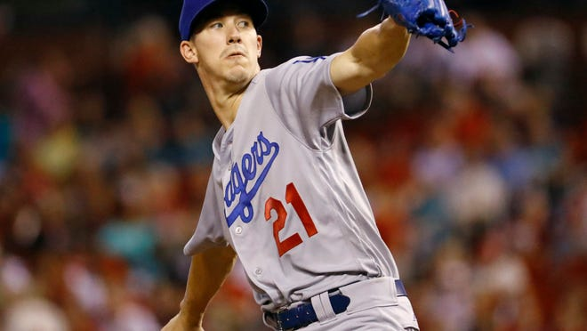 Los Angeles Dodgers starting pitcher Walker Buehler throws during the first inning of a baseball game against the St. Louis Cardinals Friday, Sept. 14, 2018, in St. Louis. (AP Photo/Billy Hurst)