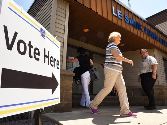 Residents in precincts 1-4 and LeSauk Township vote in the Sartell-St. Stephen school district vote Tuesday, May 24, on a $105.8 million referendum that would build a new high school and renovate and remodel other district buildings at the LeSauk Township Hall in Sartell.