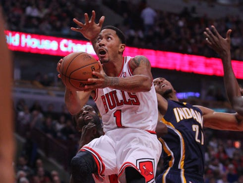 Chicago Bulls point guard Derrick Rose (1) drives past Indiana Pacers power forward David West (21) during the second quarter at  the United Center.