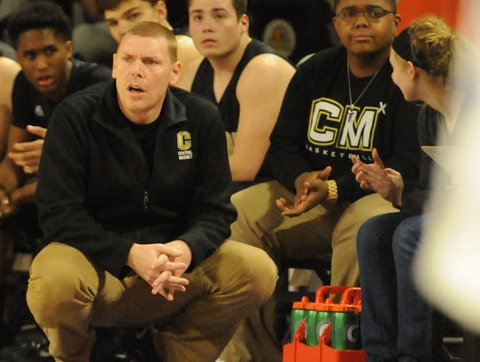 Central Magnet boys basketball coach Doug Worsley watches