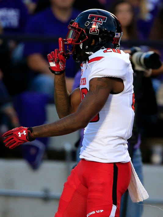 Texas Tech wide receiver Keke Coutee (20) quiets the crowd after scoring a touchdown during the first half of an NCAA college football game against Kansas State in Manhattan, Kan., Saturday, Oct. 8, 2016. Coutee was called for a personal foul on the play. (AP Photo/Orlin Wagner)