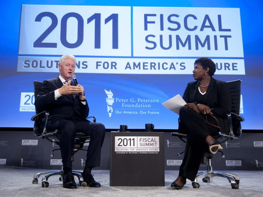 Former US President Bill Clinton as he speaks alongside Gwen Ifill of PBS' Washington Week during the 2011 Fiscal Summit by the Peter G. Peterson Foundation at the Mellon Auditorium in Washington, DC.