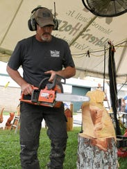 Chainsaw artist Roark Phillips carves an eagle out