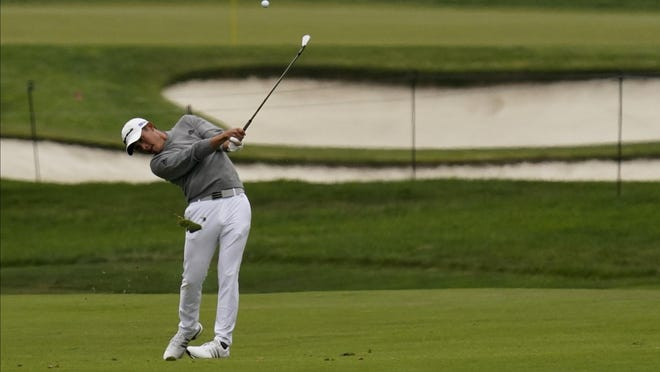 Collin Morikawa hits from the fairway on the second hole during the final round of the PGA Championship on Sunday.