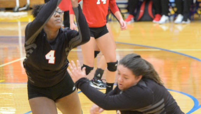 Richmond's Kiki Bentley (4) and Bekah Johnston, right, try to keep a ball in play against New Castle during the IHSAA Class 4A Sectional 9 semifinal at Greenfield-Central Saturday, Oct. 22, 2016.