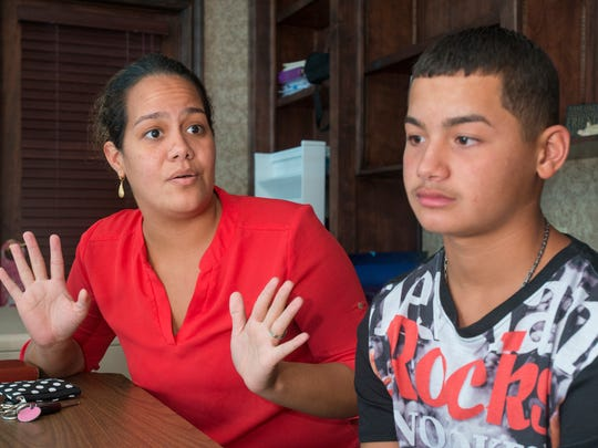Elaine Perez discusses her son eighth-grader Jelawil Robles, 13, enrollment at the Lighthouse Private Christian Academy thanks to the Stand Up For Students program in Pensacola, FL on Wednesday, August 10, 2016.  Step Up For Students is a program which provides scholarships to low-income families for their kids to attend private schools.