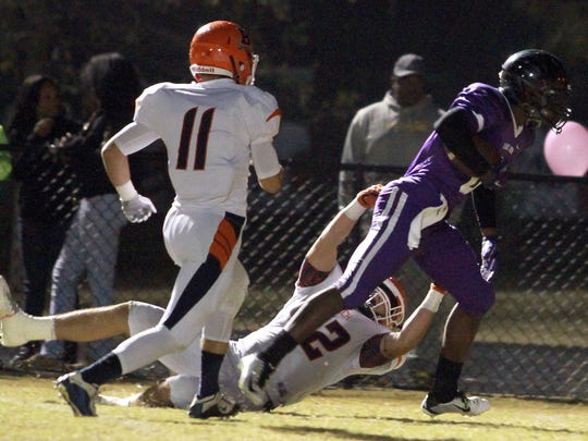 Cane Ridge's Jared McCray sheds the grasp of Beech's Heath Crabtree (42) and outruns Garrett Butler (11) to score a touchdown during Friday's second-round playoff game.