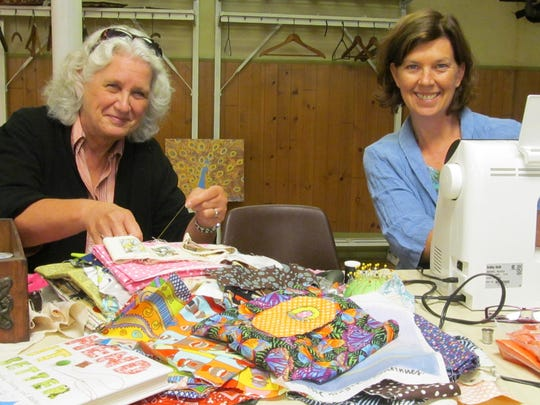 Offering sewing solutions at the Poughkeepsie Repair Cafe are Sue Silkworth .jpg