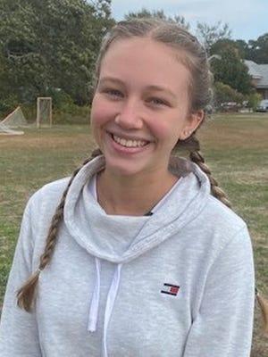 Maggie Dankert plays defense for the Navigators.