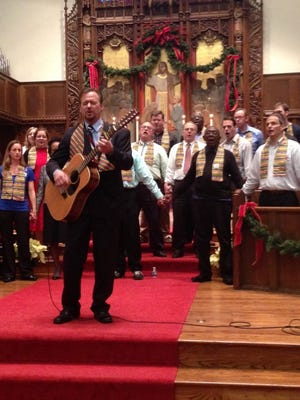 """Frank Schaefer leads the congregation in singing """"We Shall Overcome"""" during a Dec. 22 worship service at Foundry United Methodist Church in Washington."""