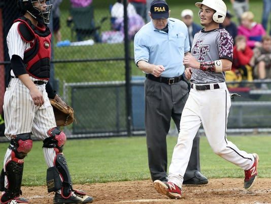 Southern Fulton's Tristan Douglas, right, scores a run against Tri-Valley on Thursday during the PIAA Class A quarterfinals. Douglas finished 4-for-4 with an RBI, two runs scored and three stolen bases in the Indians' 6-0 victory.