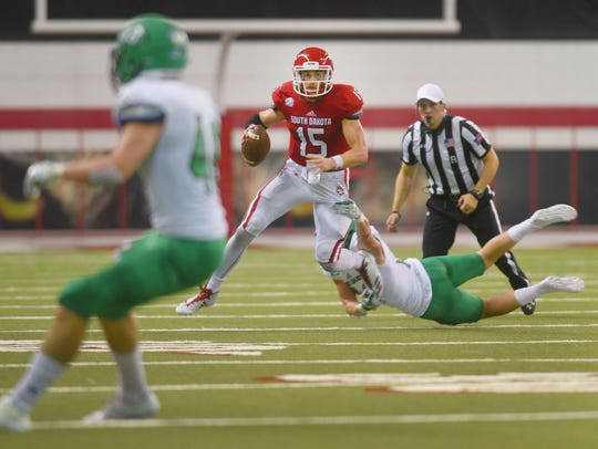USD's Chris Streveler pushes his way down the field