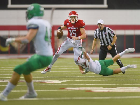 USD's Chris Streveler pushes his way down the field during the game against UND Saturday at the DakotaDome in Vermillion.