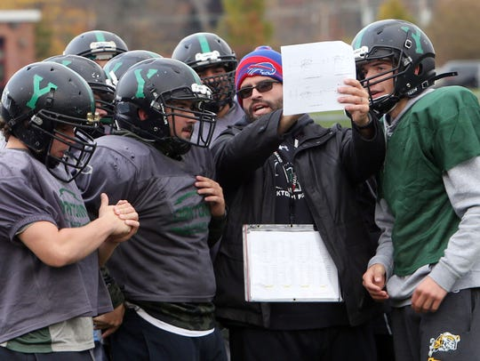 Yorktown players look over a play during practice at