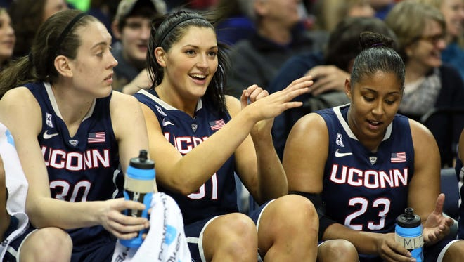 From left to right, Connecticut Huskies Stefanie Dolson, Breanna Stewart, and Kaleena Mosqueda talk during the game against the Memphis Tigers at FedEx Forum.