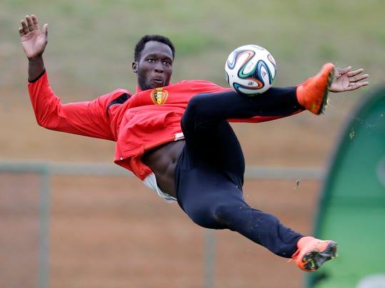 Romelu Lukaku kicks the ball during a training session of Belgium in Mogi Das Cruzes, Brazil, Thursday, June 19, 2014. Belgium play in group H of the 2014 soccer World Cup. (AP Photo/Andrew Medichini)