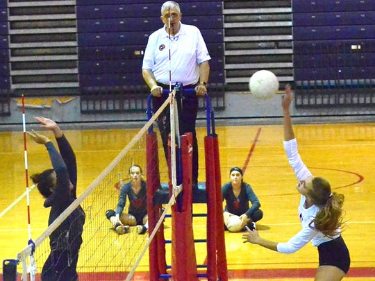 Fairview High senior Kaylee Bartee (right) leads the Lady Jackets in kills.