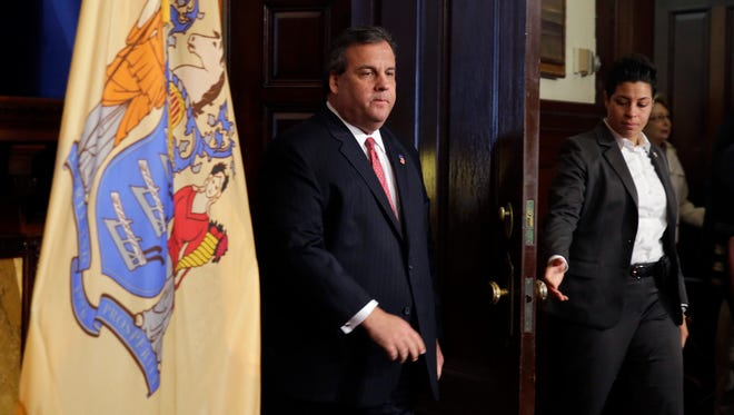New Jersey Gov. Chris Christie enters a news conference Jan. 9 at the statehouse in Trenton, N.J.