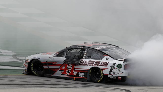 Cole Custer celebrates after earning his first career NASCAR Cup Series victory Sunday, July 12, 2020, at Kentucky Speedway.