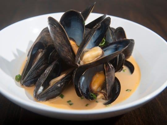Blue Bay Mussels are served with panang curry, coconut