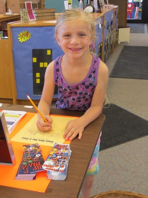Josie Twohig signed up to participate in the variety of fun activities being held this summer at the Campbellsport Public Library. For more information about the programs available, call 920-533-8534.