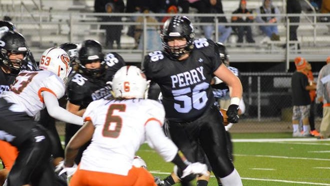 Matt Carrick (56), a junior offensive lineman at Perry High in Massillon, Ohio, became MSU's sixth commitment for its 2017 recruiting class.