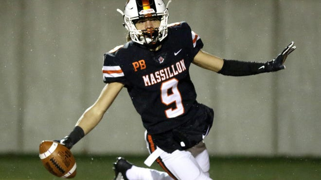 Massillon's Jayden Ballard celebrates a third quarter touchdown over Columbus Whitehall.