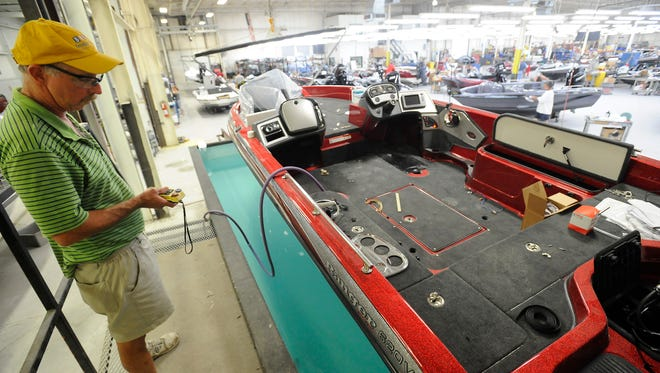 A Ranger Boats employee works on a new boat in 2011. Bass Pro has purchased Ranger Boats.