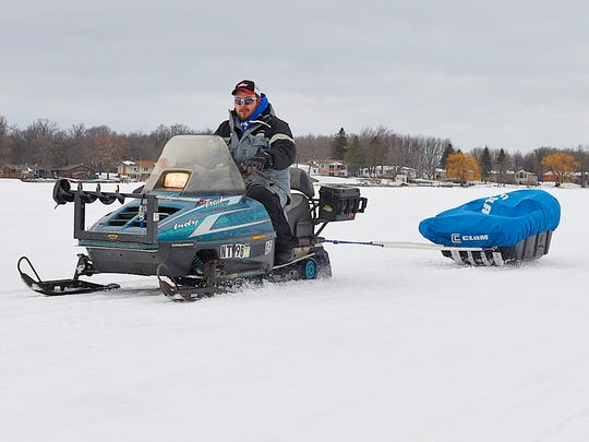 Grant Hopke, St. Augusta, heads out to do some practice fishing Wednesday, Jan 27 on Beaver Lake near Luxemburg.