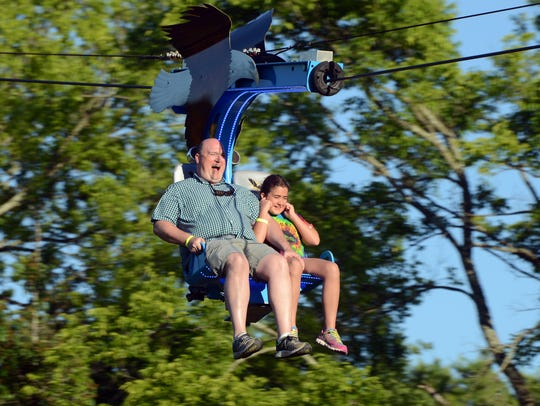 Robert Heywood and daughter Addison, 10, enjoy a ride