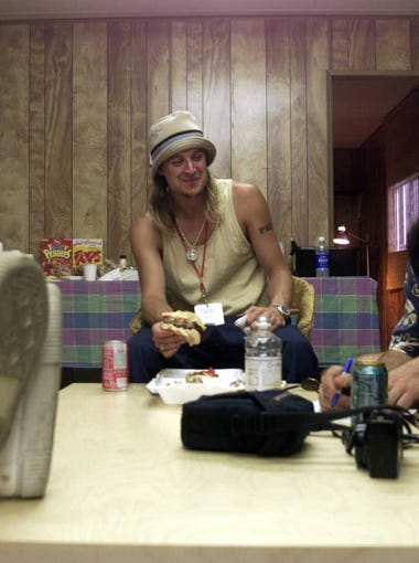 Kid Rock grabs a quick bite before going on stage at Woodstock 99 concert at Griffiss Air Force Base in Rome New York Saturday July 24, 1999.