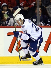 Oct 24, 2014: Tampa Bay Lightning forward Jonathan Drouin (27) celebrates his goal during the second period against the Winnipeg Jets at MTS Centre.