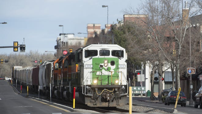 A train travels south on Mason Street in Old Town Fort Collins. Communities across Northern Colorado are trying to establish railroad quiet zones.