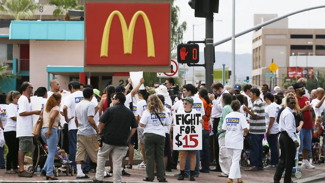 Protesters in this file photo from 2013 rally for higher wages outside a McDonald's in downtown Phoenix.The state minimum wage will remain at $8.05 in 2016.