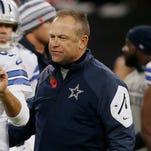 Dallas Cowboys quarterback Tony Romo (9) and Cowboys passing game coordinator Scott Linehan on Nov. 9, 2014.