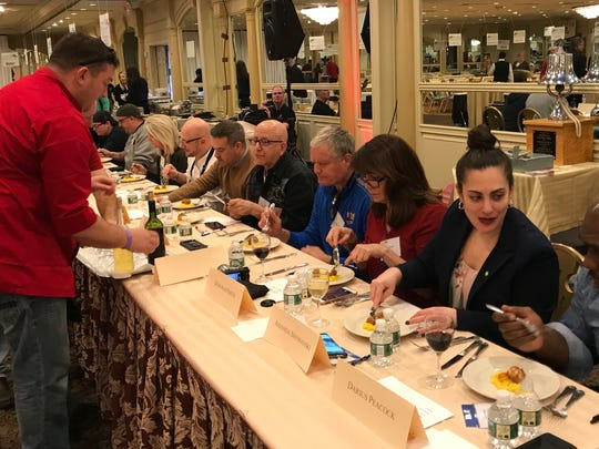 Clifton firefighters serve the judges their version of pork osso buco and risotto Milanese on Monday.