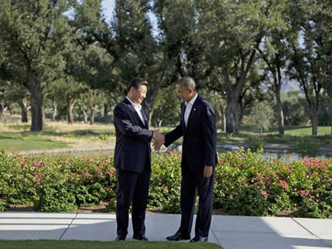 President Barack Obama shakes hands with Chinese President Xi Jinping at the Annenberg Retreat at Sunnylands as they meet for talks Friday, June 7, 2013, in Rancho Mirage, Calif. Seeking a fresh start to a complex relationship, the two leaders are retreating to the sprawling desert estate for two days of talks on high-stakes issues, including cybersecurity and North Korea's nuclear threats.