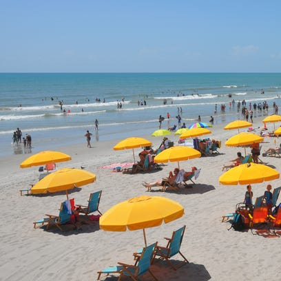 The Cocoa Beach Pier attracts crowds daily. The Space