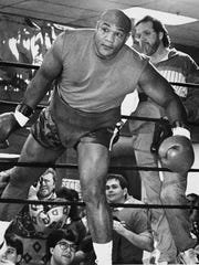 George Foreman steps into the ring for an exhibition bout against Frankfort's Rad Brewer on Nov. 21, 1990.