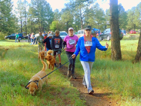 With a peppy start at the Cedar Creek trail head, these participants walked to raise money for the Humane Society of Lincoln County.
