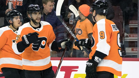 Shayne Gostisbehere, left, and Ivan Provorov have been the Flyers' top pair on defense. Each had a point in Saturday's win.