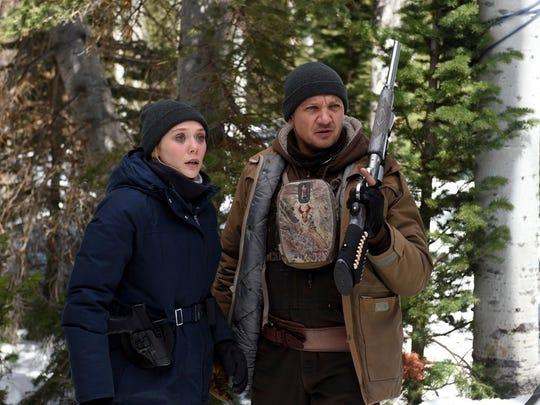 Elizabeth Olsen, left, and Jeremy Renner in a scene