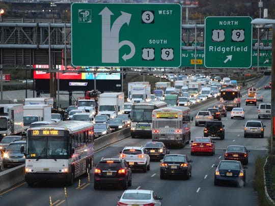 Traffic moves along the I-495 bridge to the Lincoln Tunnel Tuesday morning in North Bergen, NJ November 22, 2016. The bridge will undergo a rehabilitation to fix its structural integrity.
