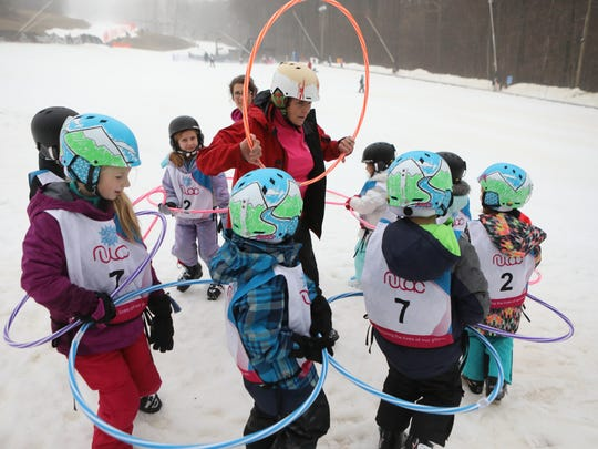 Instructor Stephanie Arendarski uses a hula hoop to teach new skiers balance at the National Winter Activity Center in Vernon.