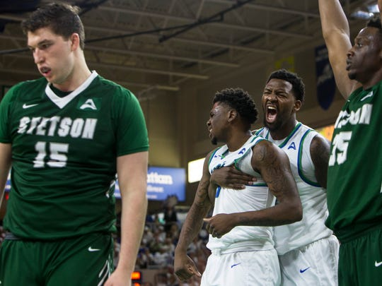 Florida Gulf Coast University junior, Antravious Simmons, #32, screams and hugs teammate Florida Gulf Coast University freshman, RaySean Scott Jr., #13, after the referee called a foul on Stetson during the game against Stetson University on Thursday, February 23, 2017 at Alico Arena in Estero.